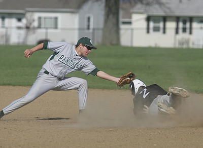 EC's second baseman Ryne St. Marie gets an off-line late throw and tries in vain to tag Padua's #2 Adam Dennison at second.  photo by Chuck Humel