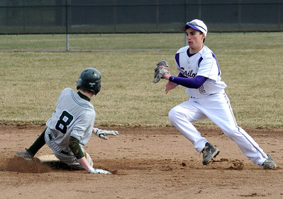 Elyria Catholic Dan Whitacre steals second base before the throw to Vermilion Gabe Skahen in first inning Mar. 31.  Steve Manheim