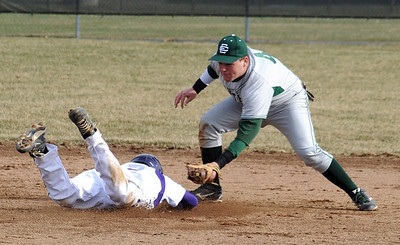 Elyria Catholic Ryne St. Marie tags out Vermilion Gabe Skahen on a steal attempt in second inning Mar. 31.  Steve Manheim