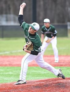 KRISTIN BAUER | CHRONICLE Elyria Catholic High School pitcher Jeff Spencer (13) pitches against Amherst Steele High School on Sunday afternoon, April 2.