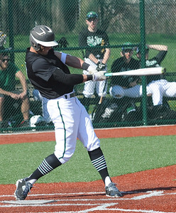 Elyria Catholic's Andrew Abrahamowicz hits an RBI single in the first inning April 18.  STEVE MANHEIM / CHRONICLE