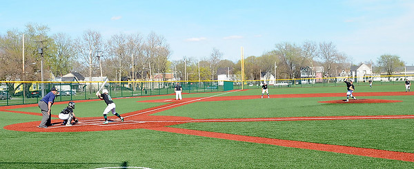 Elyria Catholic and Holy Name square off Tuesday at League Park in Cleveland. The Panthers won 5-3.  STEVE MANHEIM / CHRONICLE