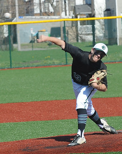 Jeff Spencer pitches for Elyria Catholic at League Park on April 18.  STEVE MANHEIM / CHRONICLE