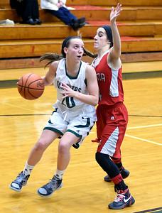 KRISTIN BAUER | CHRONICLE          Elyria Catholic High School freshman Regan Schill (10) looks to shoot the ball as Parma High School junior Jaylin Narvaez (11) guards her on Wednesday night, Dec. 9.
