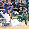 Elyria Catholic's Ryan Strittmather is tagged out at the plate by North Ridgeville's Nate Waugaman on April 21. STEVE MANHEIM / CHRONICLE