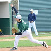 Max Menner pitches for Elyria Catholic on April 21. STEVE MANHEIM / CHRONICLE