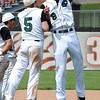 Elyria Catholic's Tony LoParo (5) and Andrew Abrahamowicz (9) celebrate the win in a regional semifinal at Massillon on May 26. STEVE MANHEIM/CHRONICLE