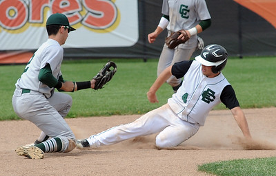 Elyria Catholic's Sean Darmafall steals second base before the tag by Canton Central Catholic's Carter Franklin in the fifth inning of a regional semifinal at Massillon on May 26. STEVE MANHEIM/CHRONICLE