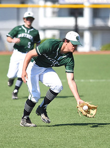 KRISTIN BAUER | CHRONICLE Elyria Catholic High School third baseman Brendan Holley (6) fields a ground ball hit during a game against Lutheran West High School on Tuesday afternoon, May 16.