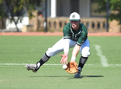 KRISTIN BAUER | CHRONICLE Elyria Catholic High School second baseman Ryan Strittmather (4) fields a ground ball hit during a game against Lutheran West High School on Tuesday afternoon, May 16.