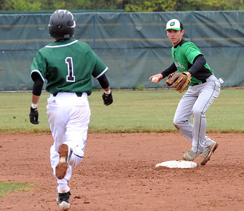 Columbia Scott Bartko turns the double play on EC Angelo Cruz in first inning Apr. 28.   Steve Manheim