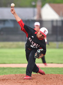 KRISTIN BAUER | CHRONICLE Elyria High School pitcher Willie Cruz-Rivera (23) pitches againat Midview on Friday afternoon, April 28.