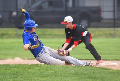 KRISTIN BAUER | CHRONICLE Elyria High School shortstop Devan Nail (7) tags Midview High School's Owen Hawke (18) out at second on Friday afternoon, April 28 after a rundown.