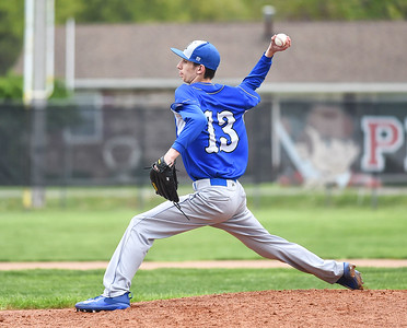 KRISTIN BAUER | CHRONICLE Midview High School pitcher Matt Kardos (13) pitches against Elyria on Friday afternoon, April 28.