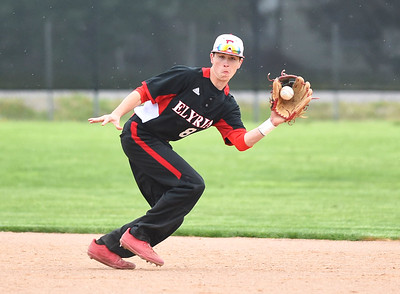 KRISTIN BAUER | CHRONICLE Elyria High School second baseman Kevin Reddinger (8) fields a hard hit ball against Midview on Friday afternoon, April 28.