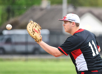 KRISTIN BAUER | CHRONICLE Elyria High School first baseman James Spicer (11) makes an out at first on Friday afternoon, April 28 during a game against Midview.