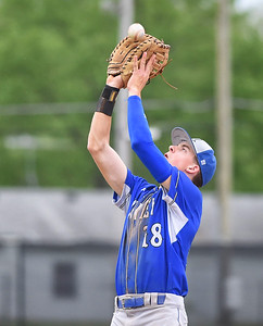 KRISTIN BAUER | CHRONICLE Midview High School first baseman Owen Hawke (18) catches a popfly for an out against Elyria on Friday afternoon, April 28.