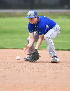 KRISTIN BAUER | CHRONICLE Midview High School second baseman Cam Honis (3) fields a ground ball hit during a game against Elyria High School on Friday afternoon, April 28.