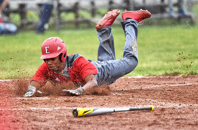 KRISTIN BAUER | CHRONICLE Elyria High School's Jamaris Cook (24) slides safely into home plate during a game against Lorain on Saturday afternoon, April 15.