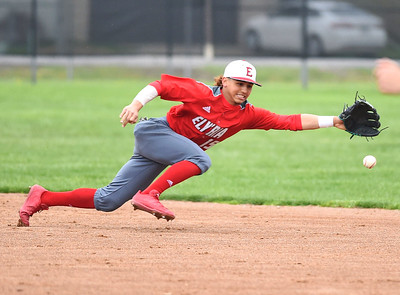 KRISTIN BAUER | CHRONICLE Elyria High School second baseman Zachary Schuster (15) dives in an attempt to catch a hard-hit ground ball during a game against Lorain on Saturday afternoon, April 15.