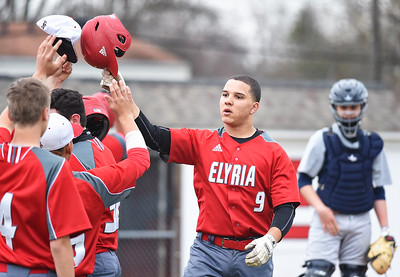KRISTIN BAUER | CHRONICLE Elyria High School's Seth France (9) celebrates a home run he hit during a game against Lorain on Saturday afternoon, April 15.