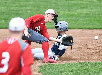 KRISTIN BAUER | CHRONICLE Lorain High School's Michael Clark (4) slides safely into second base, beating out a throw to Elyria High School shortstop Devan Nail (7) on Saturday afternoon, April 15.