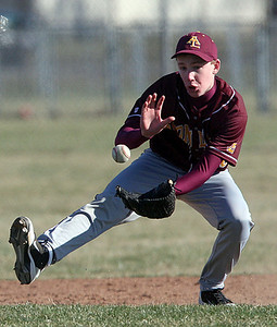 Avon Lake #15 Mark Spring puts on the brakes to grab a batted ball during the game against Elyria at Elyria