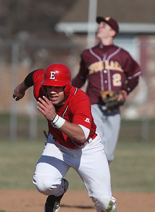 Avon Lake #2 Ryan Rodgers looks for the ball as Elyria #7 has to make a quick scarmble back to one after the batter was out during the game against Elyria at Elyria