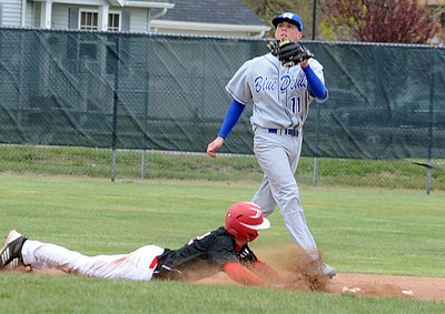 Elyria Mike Izzarelli slides safe back into second  base before the throw to Brunswick Kyle Michalik Apr 10.   steve Manheim