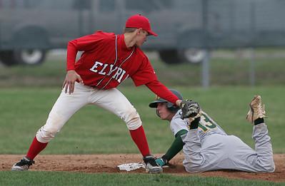 Elyria's Chris Emerson, #13 can't get a tag on Medina's Alex Thielman, also #13.  photo by Chuck Humel