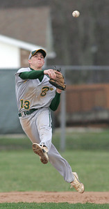 Medina's SS #13 ranges far to his right and fires a throw to first. photo by Chuck Humel