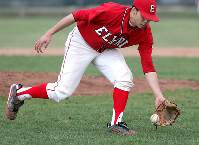 Elyria's pitcher #5 Jordan McDonald fields a bunt for a put out at first base.  photo by Chuck Humel