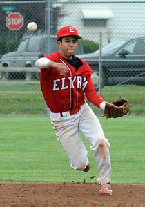 Elyria Derrick Monk makes a put out throw to first base May 12.  Steve Manheim