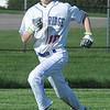 Lake Ridge's Davin Amy scores in the third inning against Open Door on April 24. STEVE MANHEIM / CHRONICLE