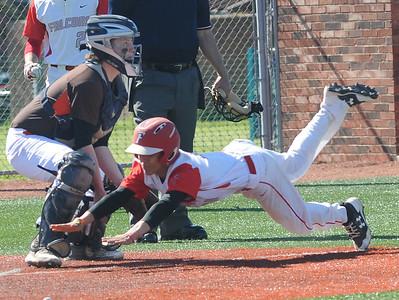 Firelands' Mason Rogonzinski scores in the first inning against Buckeye on May 15.  STEVE MANHEIM / CHRONICLE