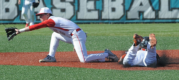 Buckeye's Ben Grega steals second base before the ball reaches FIrelands' Austin Urban in the third inning May 15. STEVE MANHEIM / CHRONICLE