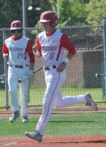 Firelands' Austin Urban scores on a balk in the first inning May 15.  STEVE MANHEIM / CHRONICLE