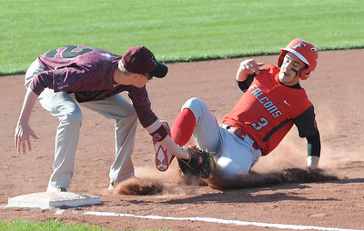 Firelands' John Gall is tagged out by Wellington's Matt Norton at third base in the first inning April 17.  STEVE MANHEIM / CHRONICLE