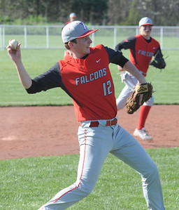 Firelands' Aaron Myers makes a throw to first base April 17. STEVE MANHEIM / CHRONICLE