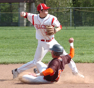 Buckeye's #13 Scott Cloudy is out at second as Firelands' #14 Joe San Felippo after stepping on second throws to first.