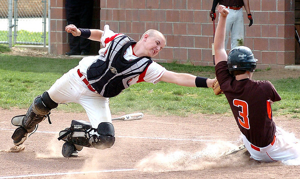 Firelands catcher #10 Tristan Clark stretches to tag out Buckeye's #3 Nick Duliba at home plate.