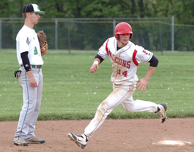 Firelands' #14 Joe San Felippo rounds second heading to third after the ball was overthrown at first.