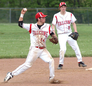Firelands' #14 Joe San Felippo throws to firstst to get Columbia's #6 out. Firelands' #5 Chris Hertrick backs him up.