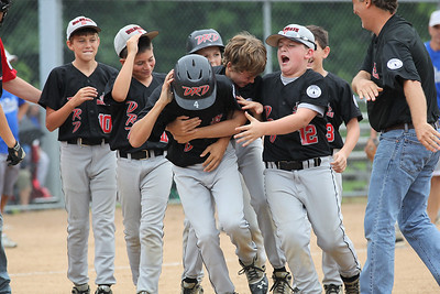 2013_07_27__Vermilion Wildcat's Jonah Pfeil is mobbed by his teammates after his 8th inning home run wins the game at the Hot Stove State semifinals in Alliance, OH. photo by Ray Riedel