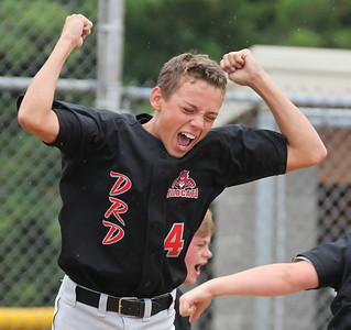 2013_07_27__Vermilion Wildcat's Jonah Pfeil celebrates his winning homerun in the 8th inning at the Hot Stove State semifinals in Alliance, OH. photo by Ray Riedel