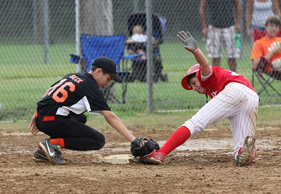 July 20 2013 ___ Fireland's Sam Dennis is safe at 3rd against Buckeye MTD at Wellington Community Park in Wellington. photo by Ray Riedel