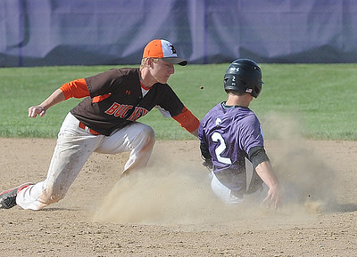 Keystone's Drew Compton is tagged out on steal attempt by Buckeye's Jake Case in fourth inning May 9. STEVE MANHEIM / CHRONICLE