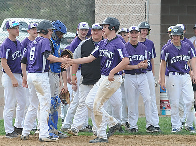 Keystone's Matthew Kellling is congratulated at home plate after hitting a two-run homer in the fourth inning against Clearview on April 20.  STEVE MANHEIM / CHRONICLE