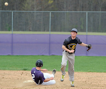 Clearview's Justyn Lilly throws to first for the double play on Keystone's Drew Compton in the third inning April 20.  STEVE MANHEIM / CHRONICLE