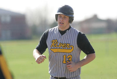 Black River's #13 Jon Sas, rounds third after cranking out a home run against Keystone to draw first blood in a home game for the Pirates.     photo by Chuck Humel